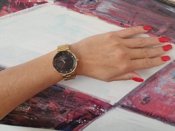 Nordgreen Philosopher Armbanduhr in Gold mit schwarzem Zifferblatt